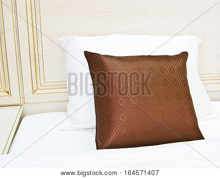 cushion pillow on the bed in the hotel
