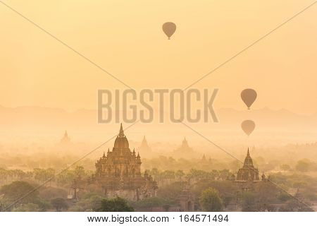 Hot air balloon over plain of Bagan in misty morning,Myanmar