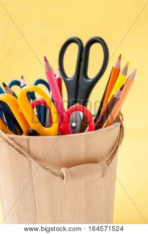 In A Wooden Bucket Are Colored Pencils And Scissors  В деревянном ведерке стоят разноцветные каранда