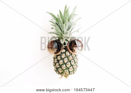 Hipster pineapple in sunglasses. Flat lay top view