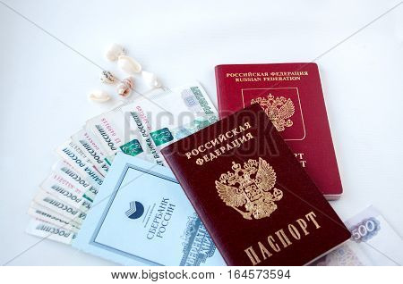 The Russian Passport Lies On The Money. The Concept Of Money For The Journey  Российский паспорт леж