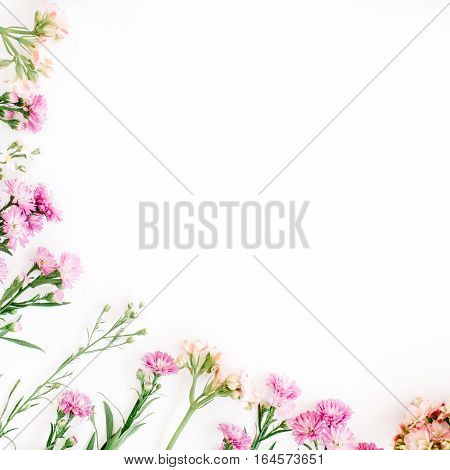 Colorful wildflowers on white background. Flat lay top view. Valentine's background