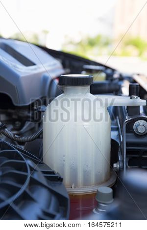 Coolant tank in car's engine for temperature control.
