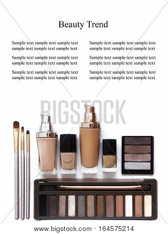 Cosmetics in natural colors and brushes isolated on white background. Makeup tools and accessories. Brow eyeshadows naturel skin foundation for clean ton on face nail polish make-up brushes.