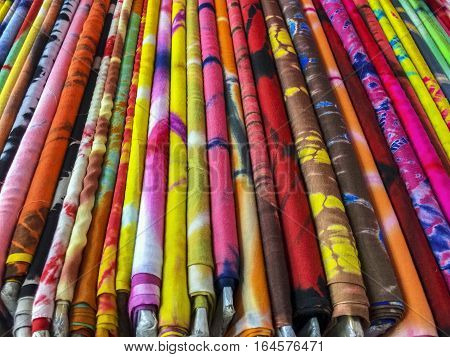Bolts of colorful cloth destined for clothing are organized in a store in the Mangaldas Market in central Mumbai.