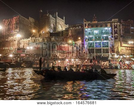 VARANASI, INDIA - NOVEMBER 14, 2016: The riverbanks of Varanasi on the evening of the Dev Diwali festival are filled with candles and lights.