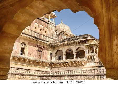 AMER, INDIA - NOVEMBER 18, 2016: The Man Singh Palace is part of the Amber Fort near Jaipur, India. This portion is framed by a traditional Islamic-style arch.