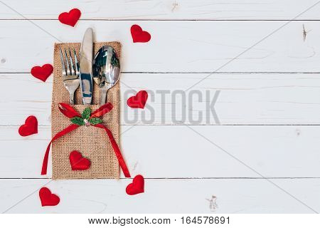Above Wood Table Set Silverware And Red Heart For Valentine Day With Space.