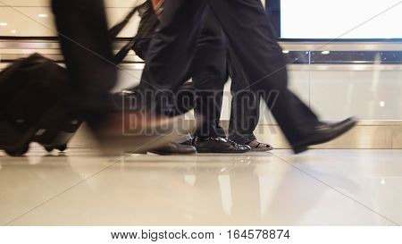 People walking with luggage in the international airport, close up shot of legs and shoes, Istanbul, Ataturk