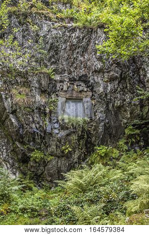Edvard Grieg and his wife Nina are buried in a cliff-hewn tomb in the grounds looking out to the Lake Nordas.