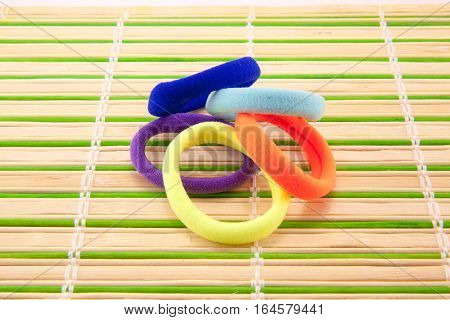 colored rubber bands for hair on the table
