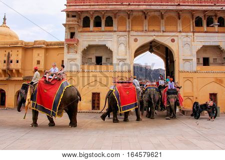 Amber, India - March 1: Unidentified People Ride Decorated Elephants Through Suraj Pol In Amber Fort