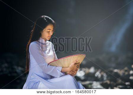 Beautiful woman with Vietnam culture traditional dresstraditional costume despairVietnam