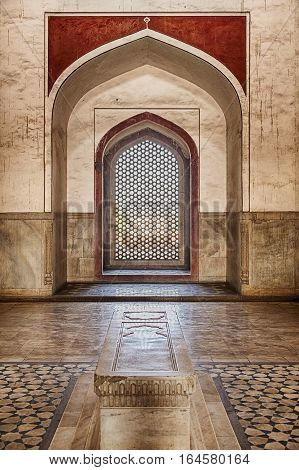 DELHI, INDIA - NOVEMBER 20, 2016: The interior of Humayan's Tomb in Delhi, India is richly decorated with inlaid stone. The building is a UNESCO World Heritage site.