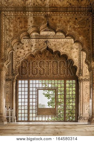 DELHI, INDIA - NOVEMBER 19,. 2016: A series of arches in the Hall of Private Audience (Divan-i Khas) in the Red Fort of Delhi, India leads to a window with a view.