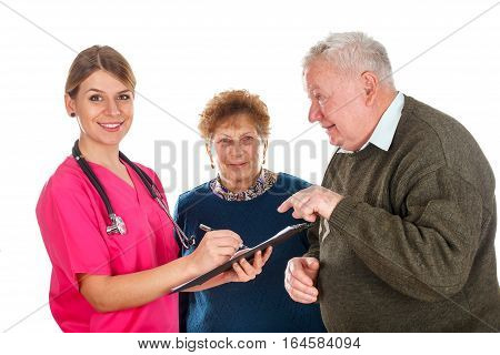Picture of an old couple with their kind physician - isolated background