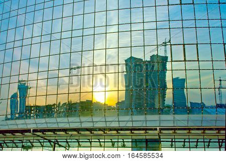 reflection of houses under construction in a modern building