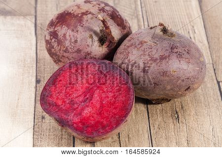 Vegetables of red beetroot ion wooden plank.