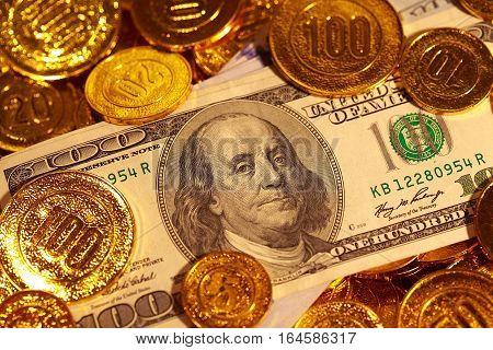 US paper money in Golden coins heap