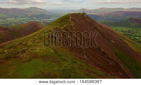 Causey Pike with Blencathra and other fells in distance, and Pennines in far distance, Lake District, Cumbria, England, UK