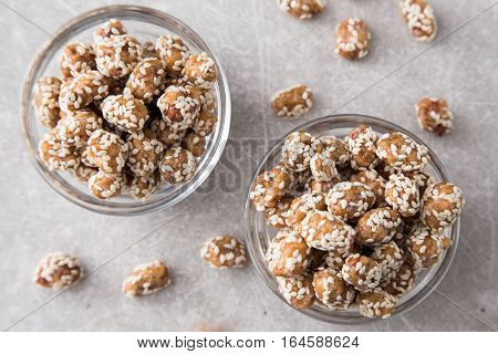 Caramel Coated Peanut With Sesame On Stone Background