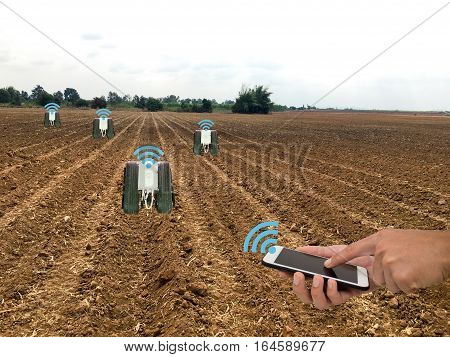 internet of things(industrial agriculture and smart farming concept)farmer use robot for keeping the data in the field by using the signal and the detector
