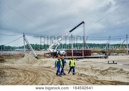 Tobolsk, Russia - July 15. 2016: Sibur company. Workers go on construction of plant on processing of hydrocarbonic raw materials