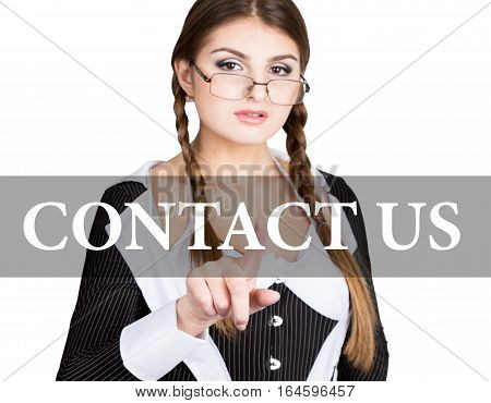 contact us written on virtual screen. sexy secretary in a business suit with glasses, presses button on virtual screens. technology, internet and networking concept