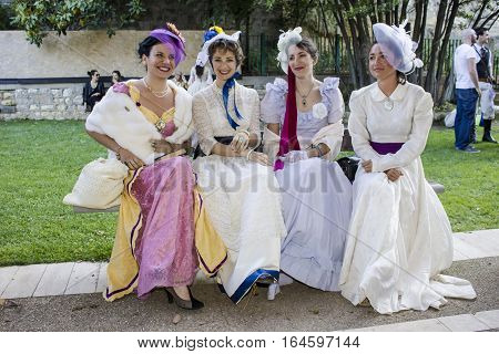 CAGLIARI, ITALY - May 29, 2016: Sunday at La Grande Jatte VIII Ed. At the Public Gardens - Sardinia - group of beautiful women in Victorian costumes
