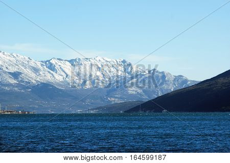 The winter sea and the snow-covered slopes
