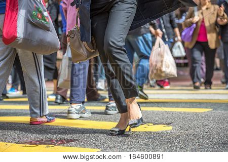 Hong Kong, China - December 6, 2016: detail of high-heeled shoes, branded bag and elegant pants suits in Causaway Bay, one of the best destinations for shopping, fashion and luxury in Asia.