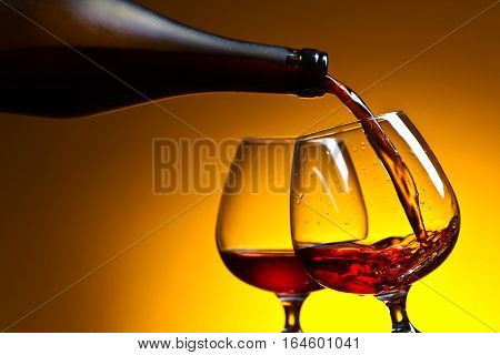 Cognac Poured Into A Glass