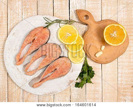 Raw Marinated Trout Fillet On Wooden Cutting Board.