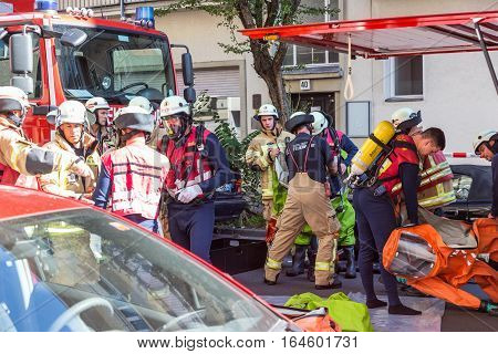 Berlin, Germany - Sept 19: Big coordinated intervention of paramedics, police, and firefighters when chemical accident happened in school in Kreuzberg on 19th of September , 2016 in Berlin, Germany.