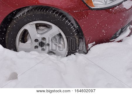 Car with winter tires on the snow covered road