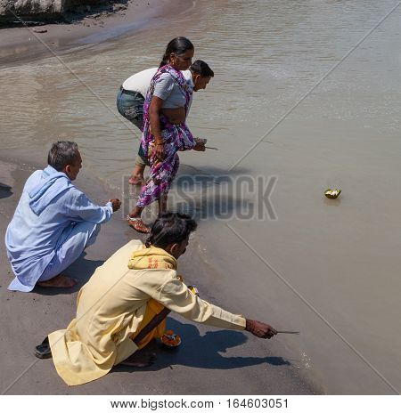 RISHIKESH, INDIA. 9 June 2009: Offerings to the Hindu pilgrims floating on the river Ganges. Rishikesh, India.