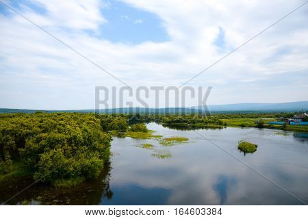 View on Lake and beautiful sky with clouds and sky-heart. Siberia Russia.