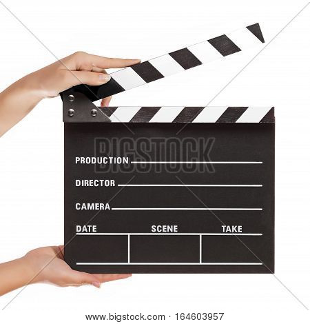 Movie production clapperboard hold by female hands.