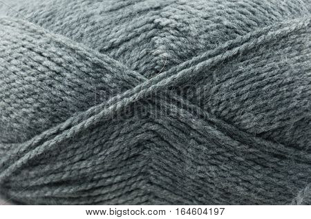 close up of a hank of gray yarn for knitting
