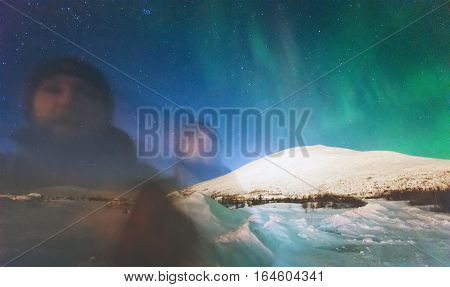Phantom man and Northern lights view above mountains Travel Lifestyle emotional psychedelic concept into the wild night scene double exposure