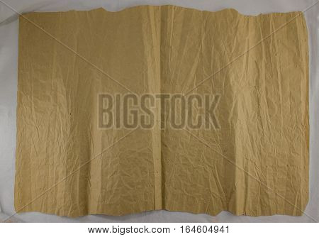 vintage texture, dark, wrinkled paper with abrasions and holes. Kraft paper