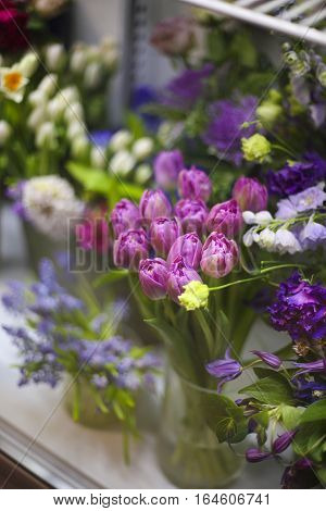 Fresh spring flowers in refrigerator for flowers in flower shop
