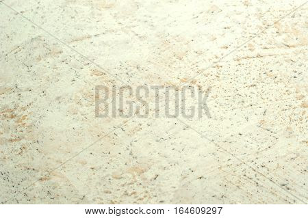 dotty decorative stucco with stone structure background