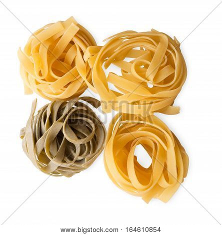 Italian rolled fresh fettuccine spinach pasta isolated on white background. Spaghetti Tagliatelle nests top view