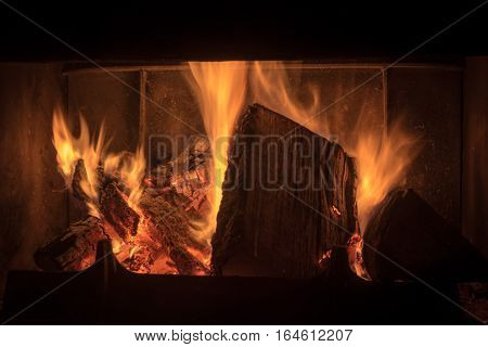 Closeup of blazes of fire in a fireplace