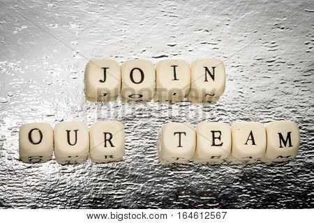 Join Our Team Text On A Wooden Cubes On A Shiny Silver Background