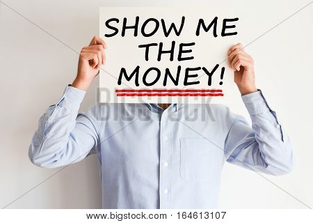 Show me the money text written on paper card suggesting employee success bonus payment