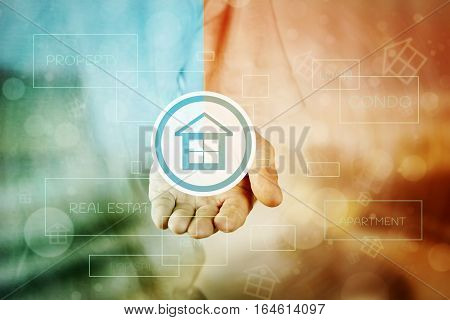 Man Hand Holding House Icon, Real Estate Property Building For Buying Or Render Architecture Concept