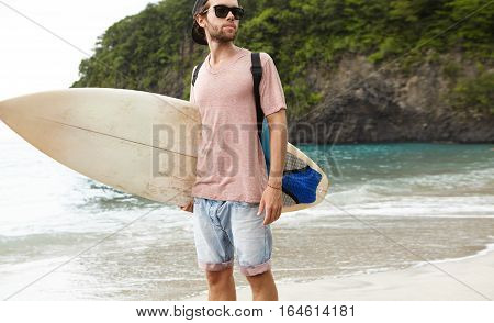 People, Holidays, Summer And Active Lifestyle Concept. Handsome Young Man With Beard Standing On Sea