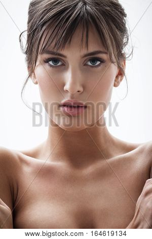 strong facial expression and emotion concept - young woman portrait with displeased negative grimace on her face